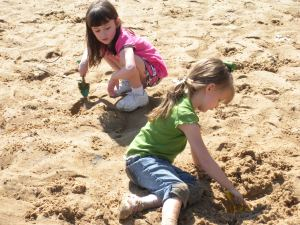 Friends playing in the sand