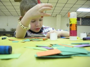 J working on his dinosaur tail