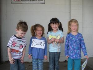 The kiddos giving me their best dinosaur roars
