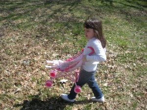 L carrying her doll stroller