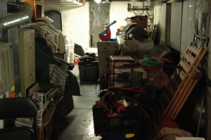 Our side of the basement is a disaster, cribs, furniture and other crap