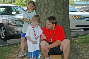 Receiving his soccer medal