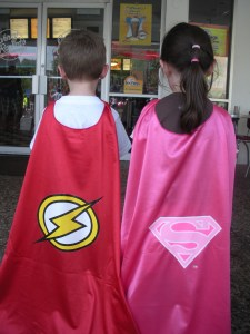 They of course got capes, The Flash for J and Supergirl for L
